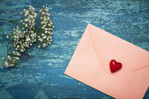 Love letter with flowers. — Stock Photo