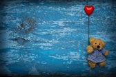 Teddy bear with heart baloon — Stock Photo