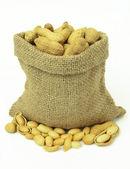 Hazelnuts in linen sack isolated on white background. — Stock Photo