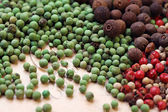 Assorted peppercorns background — Stock Photo