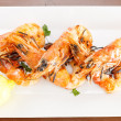 Постер, плакат: Fresh seafood starter of grilled prawns