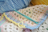 Crocheting a Multi Colored Baby Blanket — Stock Photo