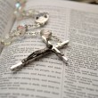 Rosery Beads Laying on an Open Bible — Stock Photo