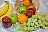 Mixed Fruits Falling Out of a Basket — ストック写真