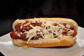 Chili Dog with Onions and Cheese — Stock Photo