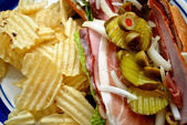 Close-Up of a Deli Meat Sandwich with Chips for Lunch — Stock Photo