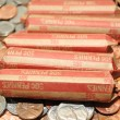 Stock Photo: AmericRolled Pennies Over Loose Change