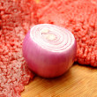 Raw Red Onion in Front of Fresh Beef — Stock Photo #39793961
