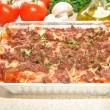 Cheeseburger Lasagna with Fresh Ingredients in the Background — Stock Photo #40286423