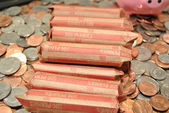 Rolled Pennies on Mixed Coinage — Stock Photo