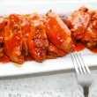 Stock Photo: Spicy Wings on a White Plate