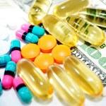Pills on Money — Stock Photo #41440525