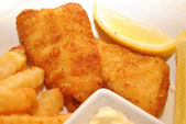 Fish and Chips with Lemon Wedges — Photo