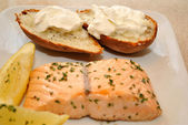 Fresh Salmon with a Side of Baked Potatoes — Stock Photo