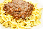 Ground Beef in Brown Gravy Over Pasta Noodles — Stock Photo