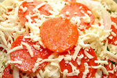 Extreme Close-Up of Raw Pepperoni Pizza — Stock Photo