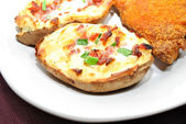 Twice Baked Potato with Chives and Bacon Pieces — Stock Photo