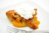 Serving of Peach Cobbler on a White Plate — Stock Photo