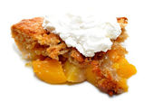 Whipped Cream on a Slice of Peach Cobbler — Stock Photo