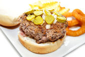 Rare Hamburger with Chopped Pickles and Onions — Stock Photo