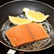 Raw Salmon with Butter and Lemon in a Fry Pan — Stock Photo