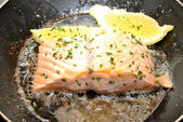 Fresh Salmon Cooking in Butter with Lemon — Stock Photo