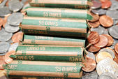 Rolled Bank Dimes on Mixed Coinage — Stock Photo