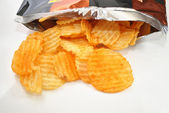 Bag of Hot Spicy Chips Spilling Out — Stock Photo