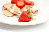 A Ripe Strawberry in Front of Fruity Hotcakes — Stock Photo