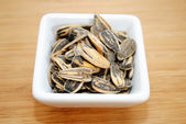 Ranch Flavored Sunflower Seeds in a White Square Bowl — Stock Photo