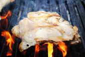 Raw Chicken Thigh on a Flaming Grill — Stock Photo