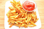 Spicy Fries Served on a White Plate with Catsup — Stock Photo