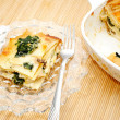 Eating Spinach Lasagna Served on a Glass Plate — Stock Photo #49289139