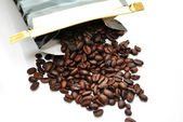 Fresh Coffee Beans Spilling Out of a Bag — Stock Photo