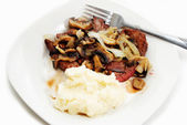 Steak with Mushrooms and Onions with Mashed Potatoes — Stock Photo