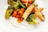 Stir Fried Chicken and Vegetables Served Over White Rice — Stock Photo