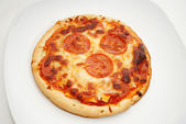 Personnal Size Pepperoni Pizza Served on a Plate — Stock Photo