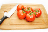 Tomatoes on a Cuting Board with a Knife — Stock fotografie