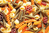 Background of Different Flavored Pasta Shapes — Stock Photo