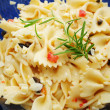 Close Up of Fresh Rosemary on Top of Pasta Salad — Stock Photo #51279425