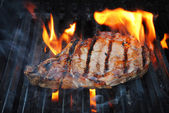 Flame Grilling a Lean Beef Steak — Stock Photo