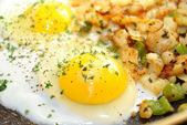 Close-Up of Eggs and Potates in a Pan — Stock Photo