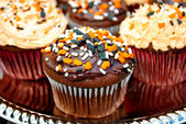 Chocolate Halloween Cupcakes with Festive Sprinkles — Stock Photo