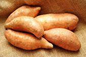 Close-Up of 5 Sweet Potatoes on Burlap — Stock Photo