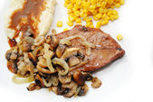 Delicious Steak Covered with Sauteed Mushrooms and Onions — Stock Photo