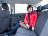 Attractive young woman in car — Stock Photo