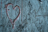 Heart carved on a wall — Stock Photo