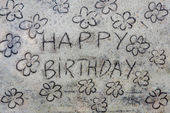 Happy birthay inscription on sand — Stock Photo