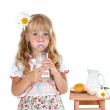 Little girl with milk mustache after drinking milk — Stock Photo #38106595