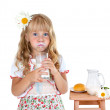Little girl with milk mustache after drinking milk isolated on white background — Stock Photo #38836659